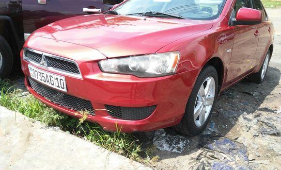 Voiture à vendre Mitsubishi Lancer Rouge - Kinshasa - Ngaliema