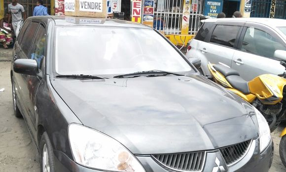 Voiture à vendre Mitsubishi Lancer Gris - Kinshasa - Masina